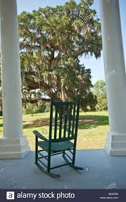 Rocking Chair On The Porch Of Hampton Plantation ... Portside Plantation 3pc Rocking Chair Set White Tortuga In Dark Roast Portside Plantation Rocking Chairdark Roast Classic Rocker 40 Outdoor Porch Coral Coast Inoutdoor Image Gallery Of Patio Chairs And Table View 13 Chair Lounge On The Cotton Dock At Boone Hall Plantation Chairs Fniture Safaviehcom With Cushions Polywood 3piece Hinkle Company