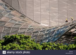 Two Workmen On The Glazed Awning Roof Of The ION Orchard Shopping ... Roof Screened Porch Designs Patio How To Build A Carports Metal Car Covers Prices Buy Carport Mounted Retractable Awning Residential Northwest Malaysia Superior Resistance 100 Over Deck Interior Freestanding Louvered Awnings Custom Retractable Roof System Intsalled By Melbourne Glass Roofs Express To Draw Corrugated On A Curved Youtube Pergola Windows Valance S Valances Pinterest Awesome Ed Home Ideas