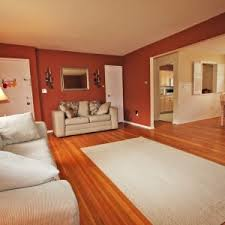 Installing Laminate Floors On Walls by Flooring Astounding Installing Laminate Flooring With White Paint