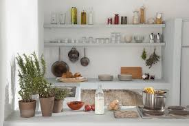 Rustic Kitchen In White Pale Gray Shelves With Cups And Glasses Pans