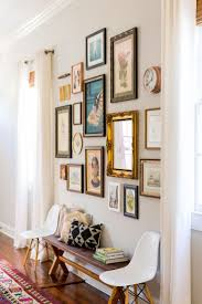Antique And Vintage Touches Make This Hallway Gallery Wall A True Gem Eames Chairs An Entryway Bench Add More MAKE BENCH BAR Console Table Could Be