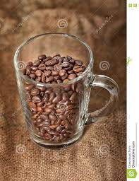 Download Coffee Beans In A Transparent Cup On Sacking Background Stock Image