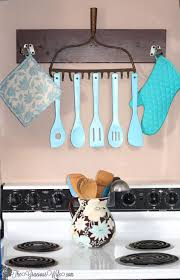 35 Best DIY Kitchen Decorating Projects 1 Upcycled Old Rake To Rustic Utensil Holder