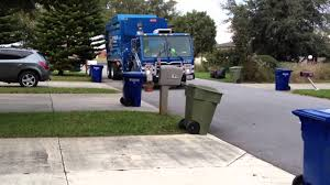 Garbage Truck Picking Up Recycle Waste - YouTube