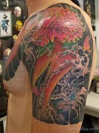 Asian Flower Tattoo Design On Shoulder