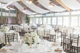 Rustic Wedding Venue With White And Gold Winter Decorations