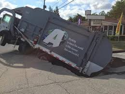 100 Trucks And More Augusta Ga Dump Truck Gets Stuck In Sinkhole Macon Telegraph