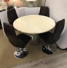 Round Italian Travertine Dining Table Surrounded By Four Matching Danish Signed Johansen Design Swivel Tuip Chairs