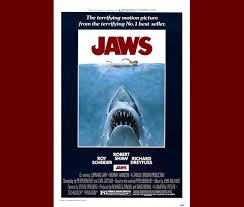 Ill Accept No Arguments Here A Giant Shark Torpedoes Toward An Unsuspecting Swimmer In The Movie Poster That Made Hotel Pools Requirement