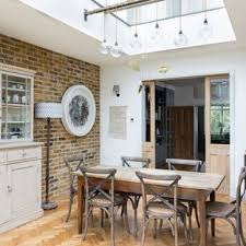 Inspiration For A Medium Sized Eclectic Dining Room In London With White Walls Light Hardwood