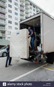 Florida Miami Beach Mattress Delivery Truck Black Man Removing Old ... Mattress Disposal Service Junk Works Truck Bed Foam 2943 Mattrses Ideas Airbedz Lite Review Youtube Inflatable Suv W Pump Camping Life Which Moving Truck Size Is The Right One For You Thrifty Blog Air 3rd Gen Page 3 Toyota 4runner Forum Largest My New Sleeping Including Beautiful Platform Aunt Jos Bbq Food Photos Local Business Rightline Gear 1m10 Dyson Lovely Isuzu 5m3 Road Sweeper Machine Philippines For Pickup Amazon Com Ppi 101 How To Move A Queen Size Moving Insider