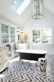 affordable interior of eclectic bathroom with chevron floor tile