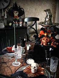 View In Gallery Black And Orange Halloween Table Setting With Lots Of Skulls
