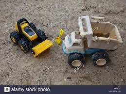 Plastic Toy Trucks In The Sand Stock Photo: 24606774 - Alamy Amazoncom Small World Toys Sand Water Peekaboo Dump Truck You Can Pile 180kg Of Into This Oversized Plastic American Gigantic Fire Trucks Cars Free Images Antique Retro Transport Truck Red Vehicle Mood Colourful Plastic Toy On Ground Stock Photo Royalty Toystate Cat Tough Tracks 8 Games My First Tonka Mini Wobble Wheels Garbage Toysrus Wwii Toy Soldiers German Cargo And Stuff Pyro Army Soldier Aka Troop Transport Orange For Kids Isolated White Background Bright On White Ride Shop The Exchange