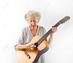 Aged Woman Playing Acoustic Guitar Stock Photo
