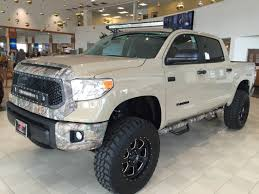 Custom Toyota Tundra Trucks Toyota Tundra Trucks With Leer Caps Truck Cap 2014 First Drive Review Car And Driver New 2018 Trd Off Road Crew Max In Grande Prairie Limited Crewmax 55 Bed 57l Engine Transmission 2017 1794 Edition Orlando 7820170 Amazoncom Nfab T0777qc Gloss Black Nerf Step Cab Length Cargo Space Storage Wshgnet Unparalled Luxury A Tough By Devolro All Models Offroad Armored Overview Cargurus Double Trims Specs Price Carbuzz