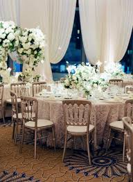 Reception Décor Photos - Textured Linens, Silver Chairs In Ballroom ... Regal Fniture How To Plan Your Wedding Reception Layout Brides Syang Philippines Price List For Usd 250 Simple Negoation Table And Chair Combination Office Chair Conference Table And Chairs Admirable Round Ikea Business Event Seating Arrangements Whats The Best Your Event Seating Setting Events Budapest Party Service Tables Chairs Negotiate A Square Four Indoor Flowers Stock Photo Edit Now