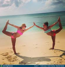 Yoga Poses Around The World Sisters Doing On Beach