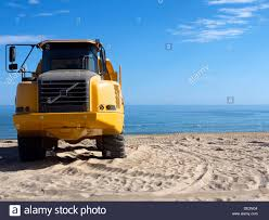 Front View Of A Big Yellow Truck For Shifting Sand Around The Beach ... The Big Yellow Truck On The Road Cars Trucks Cstruction Stock Photo Picture And Royalty Free Image Front View Of Big Yellow Ming Truck Vector Big Yellow Truck Cn Rail Trains And Cars Fun For Kids Youtube Ming Against Blue Sky Rolling Through Southaven Jr Restaurant Group Transport Graphic On Road In City Vehicles 1949 Paul Malon Flickr Of Tipper A Dump Isolated White
