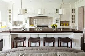 View In Gallery White Kitchen With A Large Island And Dark Contrasting Countertop