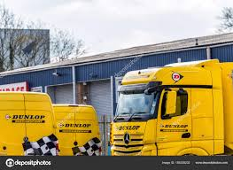 Daventry UK March 13 2018: Dunlop Motorsport Logo On Trucks And Vans ... Refrigerator Truck Van Dealership Houston Chastang Ford Sales Pipefab Co Laois Ireland Grill Bars Roof Bars Light Family Trucks And Vans Denver Co 80210 Car Auto Renault Electrified The French Cook Serial Electric Trucks Vans Used Cars Corpus Christi Tx Fleet Street Food By Kruglivector Thehungryjpegcom Daventry Uk March 13 2018 Dunlop Motsport Logo On New Chevrolet For Sale Capitol In Refrigerated Vans Trucks Bush Specialty Vehicles And Best Image Kusaboshicom