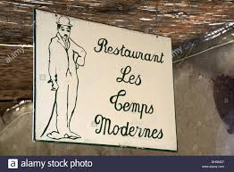 sign for chaplin restaurant modern times or les temps
