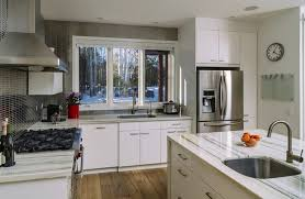 Sharp White Cabinetry Meets A Micro Tile Backsplash In This Highly Detailed Cozy Kitchen