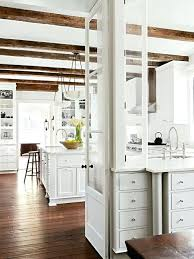 White Kitchen Wood Floors Example Of A Mountain Style Design In Other With Glass Front