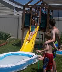 Come Out When You're Happy: How To Turn Your Backyard Slide Into A ... 25 Unique Slip N Slide Ideas On Pinterest In Giant Backyard Water Parks Splash Recycled Commerical Water Slides For Sale Fix My Slide Diy Backyard Outdoor Fniture Design And Ideas Residential Pool Pools Come Out When Youre Happy How To Turn Your Into A Diy Pad 7 Genius Hacks Sprinklers The Boy Swimming Pools Waterslides Walmartcom N But Combing Duct Tape Grommets Stakes 54 Best Images Summer Fun 11 Infographics Freeze