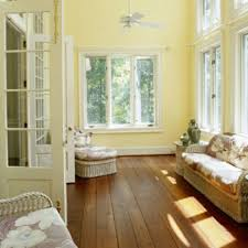 Sunroom Decor Ideas Colors Classic Design Brown Wood Floor Painted Yellow Wall With White And Metal Window Frame Great But Simple Remodeling