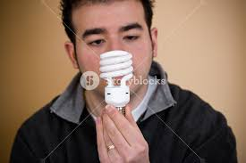 a holding an energy saving compact fluorescent light