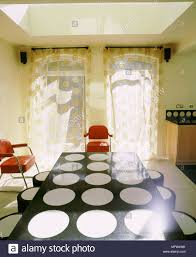 Modern Dining Room Sheer Curtains Black Table With White Circle Design Red Chairs