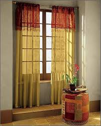 Gold And White Sheer Curtains by Beauty In White Window Curtain Treatment In Dining Space With