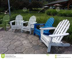 Adirondack Chairs, Green, White, And Blue Lounge Chairs In A Public ... Modern Rocking Resin Adirondack Chair Loll Designs Cushions Lowes Fresh Pool Lounge Chairs At Amazoncom Polywood Adirondack Chair With Retractable Ottoman Cedar Dfohome Chaise Adjustable Back Outdoor Style Log Made In Usa Reclaimed Wood Save The Planet Fniture Simple Wooden Old Envirobuild Deck Recline Able Pullout