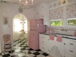 Minimalist Vinatge 50s Kitchen Decor With Two Small Windows And Pink Refrigerator Also Chandelier Lamp