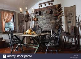 Dining Room Table And Chairs In Early American Primitive Style Stock ... Modern Traditional Style Home Fniture Roundup Emily Henderson Primitive Ding Room Sets Unique Beautiful Best Decore Pinterest Amazon Indiginous Tribe Table Stock Photo Image Of Wooden The Wool Cupboard Ding Table Windsor Chair And Candelabra My Antique American Tilt Top Tavern Chair Colonial Christmas Cheer Decorating Americanablack Hutch Chairs Inspiration Horrible For Elm Images About Kitchen Union Rustic Shoemaker 5 Piece Set Wayfair Magnolia Robert Sonneman Urban Chairish By Joanna Gaines 7