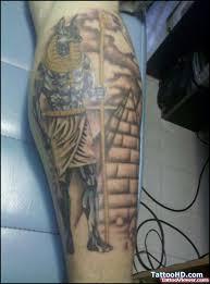 Egyptian Pyramid And Anubis Tattoo On Leg
