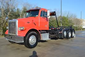 Used 2004 Peterbilt 357 Tri Axle Roll Off In Brookshire , TX