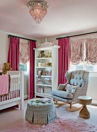 pink and gray nursery with pink pom pom curtains
