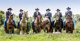 Groom And Groomsmen Riding Horses Wearing Cowboy Hats Jeans