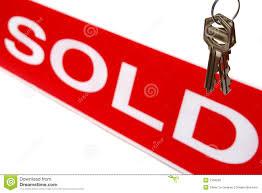 Real Estate House Keys And Realtor Sold Sign