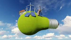 light bulb is covered with green grass solar panels wind energy