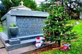 A Christmas Tree Accompanies The Gravesite Of Some Loved Ones In This Recent Photograph Taken At