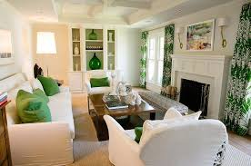 built in fireplace cabinets under windows transitional living room