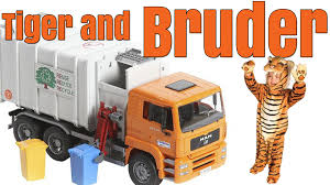 Tiger Playing With The Orange Bruder Garbage Truck #toytrucks ... Buy Bruder Man Tga Rear Loading Garbage Truck Orange 02760 Scania R Series 3560 Incl Shipping Large Kit Toy Dust Bin Cart Lorry Mercedes Tgs Rearloading Garbage Truck Greenyellow At Bruder Scania Rseries Toy Vehicle Model Vehicle Toys 01667 Mercedes Benz Mb Actros 4143 Green Morrisey Australia 03560 Rseries Newfactory Man Cstruction Red White Online From Fishpdconz