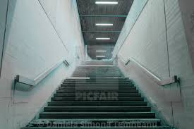 100 Concret Walls Staircase With Concrete Walls And Metal Railings License