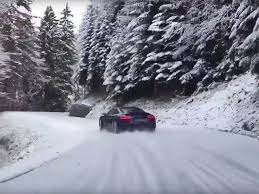 Watch This Audi R8 Drift Inches From A Cliff Snowy Mountain Road