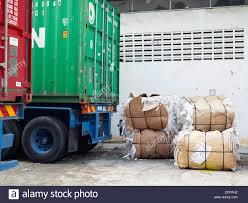 100 Trucks Paper Bundles Of Recycled Waste Paper Near Freight Trucks At A Printing