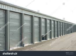 Storage Units At A Facility With One Door Partially Open