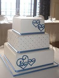 Elegant White Butter Cream Wedding Cake With Navy Blue Scrolls
